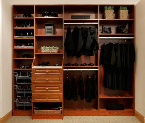 Traditional Closet with dark wood closet system