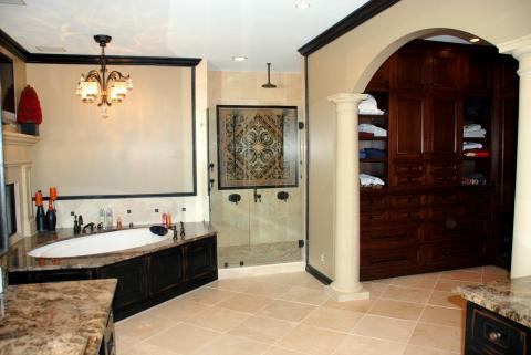 Traditional Master Bathroom with black tile diamond accents