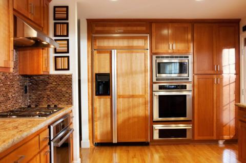 Modern Kitchen with side by side refrigerator with cabinet door paneling