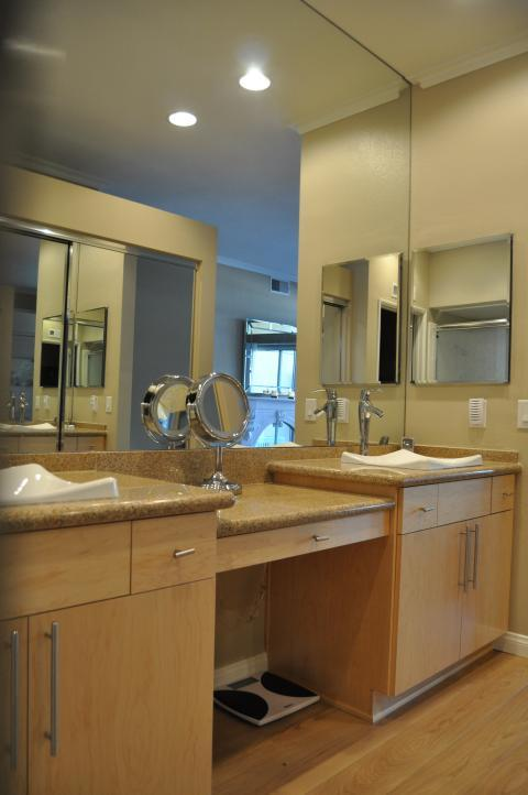 Contemporary Master Bathroom with light wood vanity cabinets