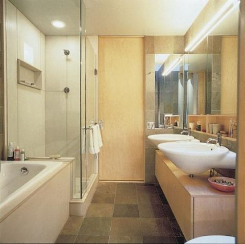 Contemporary Master Bathroom with frameless glass shower door