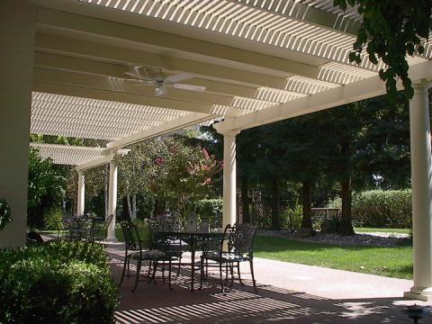 Traditional Patio with off white columns around patio