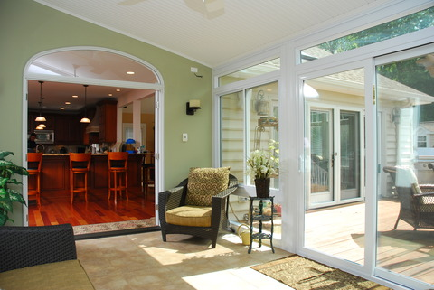 Traditional Sunroom with light green painted walls