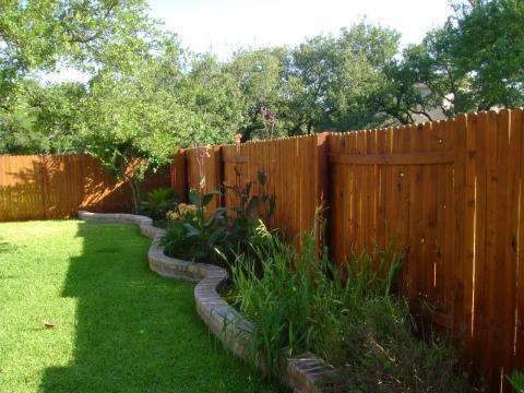 Traditional Landscape with medium wood privacy fence