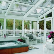 Traditional Sunroom with white wicker patio furniture