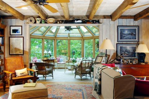 Traditional Family Room with displayed antiques on shelves above doorway