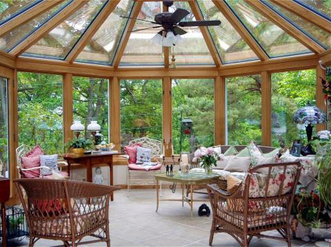 Eclectic Sunroom with light wood stained millwork