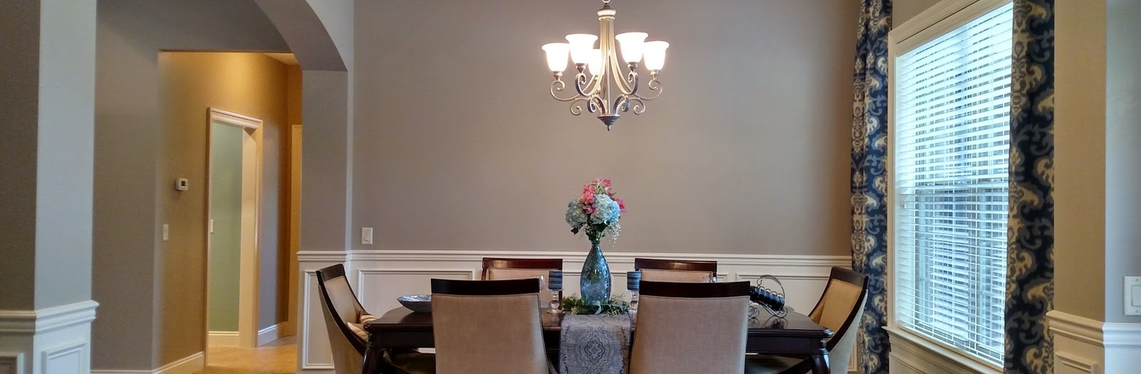 French Country Dining Room with white crown molding