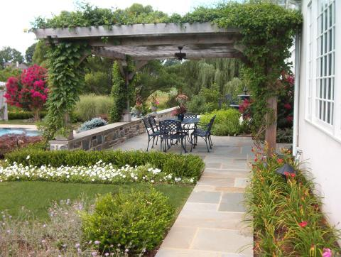 Traditional Patio with black metal outdoor patio furniture
