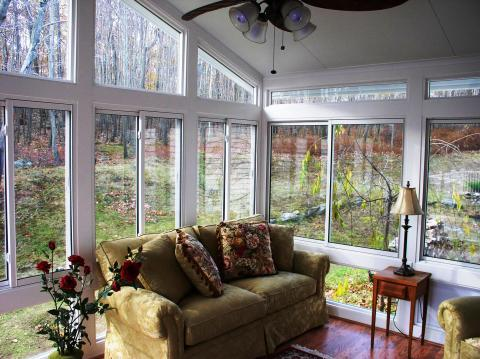 Contemporary Sunroom with red wood stained floor