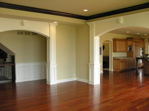 Traditional Family Room with dark wood stained crown molding