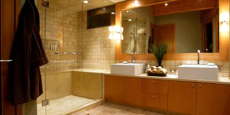Contemporary Bathroom with light wood stained cabinets