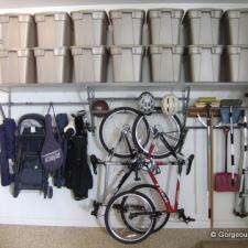 Traditional Garage with wall hung organizational shelves