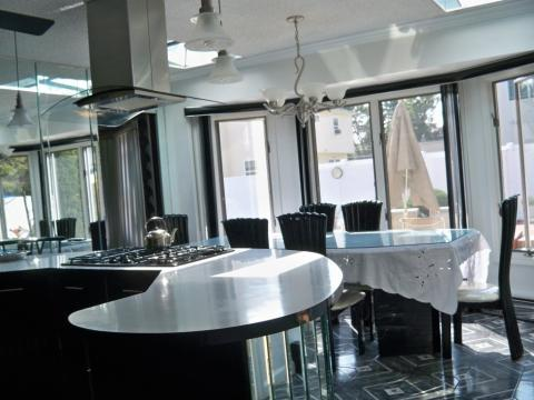 Contemporary Dining Room with stainless steel stove hood