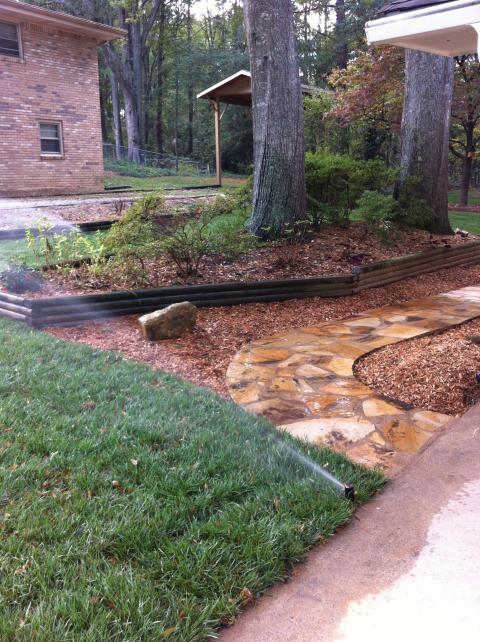 Eclectic Landscape with mortared stone walkway