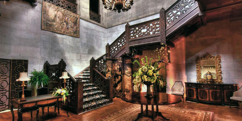 Tudor Staircase with dark wood detailed stair railing