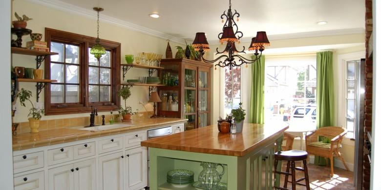Cottage Kitchen with tall dark wood china cabinet with glass doors