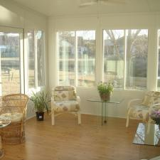 Traditional Sunroom with glass top occasional tables