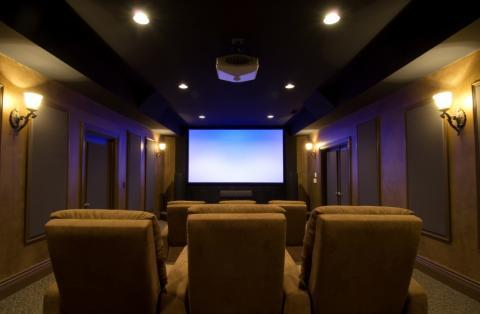 Traditional Home Theater with tan overstuffed recliner chairs