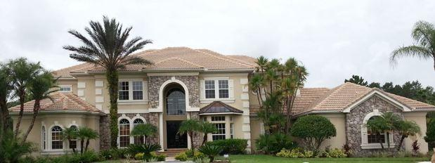Home Exterior with terra cotta roof tiles