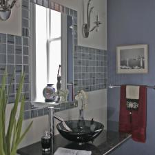 Eclectic Bathroom with wall mounted granite counter