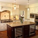 Transitional Kitchen with full tile backsplash with bordered accent