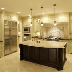 Traditional Kitchen with full tile backsplash with framed accent