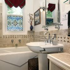 Eclectic Bathroom with faucet fixture mounted on wall