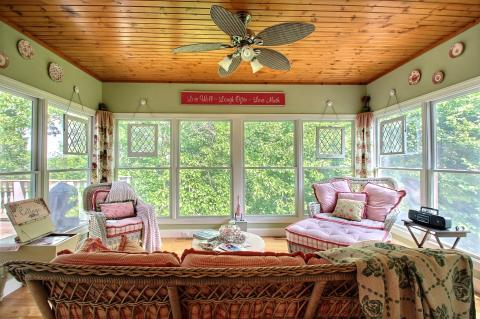 Cottage Sunroom with light rustic wood ceiling covering