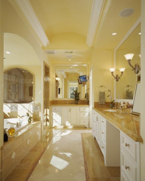 Traditional Bathroom with large white framed wall mounted vanity mirrors