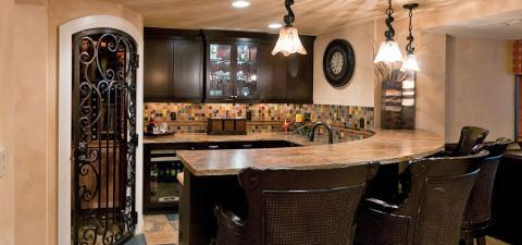 Eclectic Kitchen with light brown stone slab counter tops