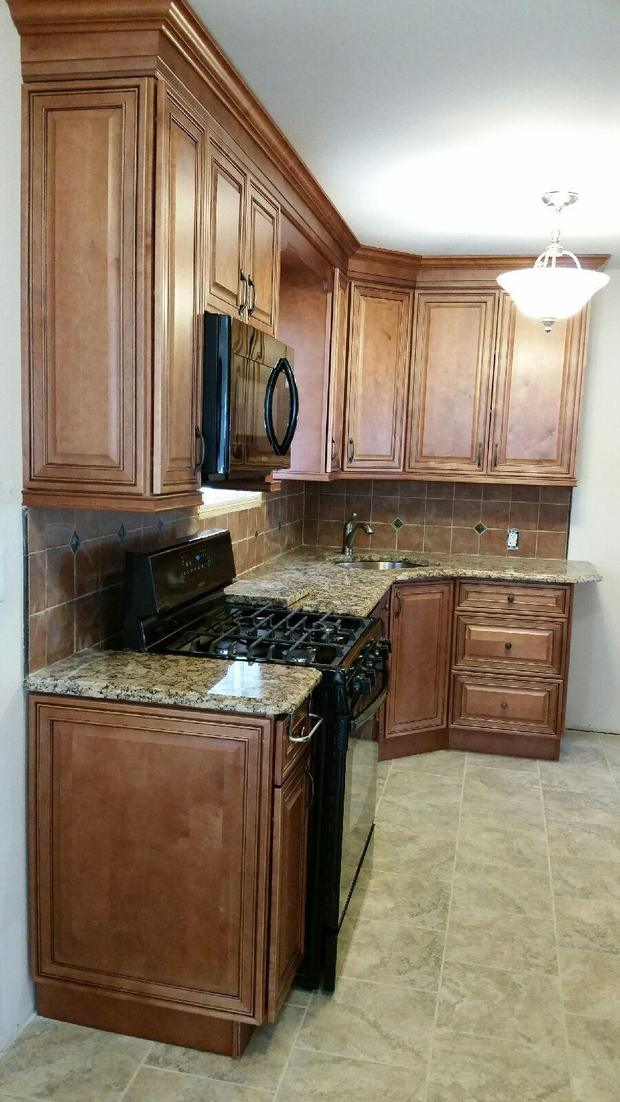 Traditional Kitchen In Queens Village Wood Cabinets Brown Tiles By Moken Home Improvement