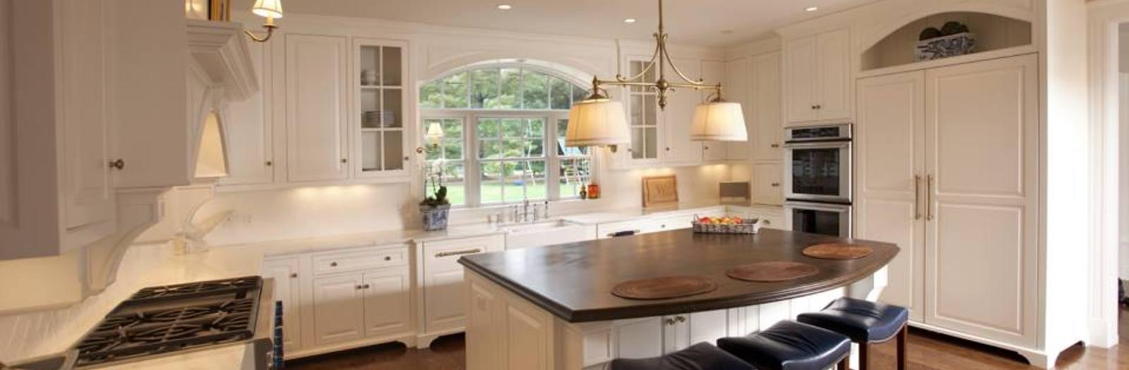 Transitional Kitchen with waterfall edge wood island top