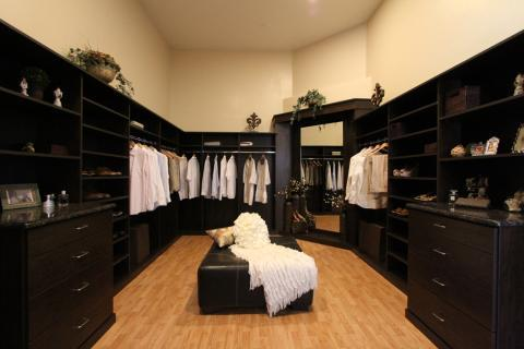 Transitional Closet with large dark brown leather upholstered ottoman