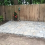 Yard with brick paved patio