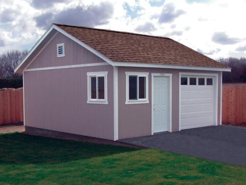 Traditional Garage with white framed windows and doors