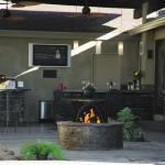 Traditional Outdoor Kitchen with large wall mounted flat screen tv