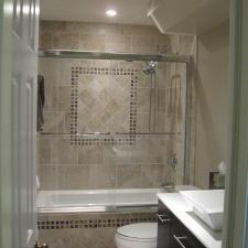 Transitional Bedroom with chrome framed glass shower door
