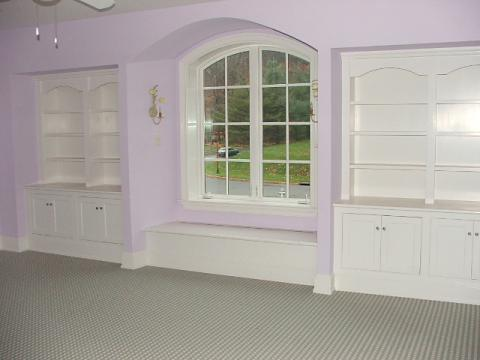 Traditional Family Room with mission style cabinet doors
