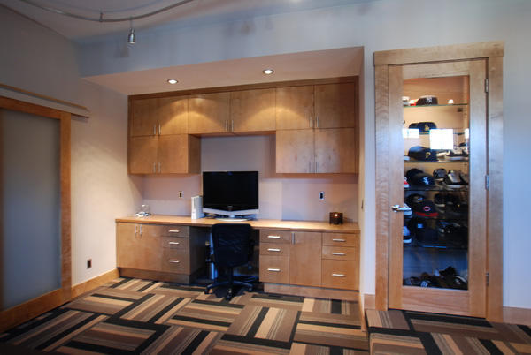 Transitional Home Office With Light Wood Built In Cabinets