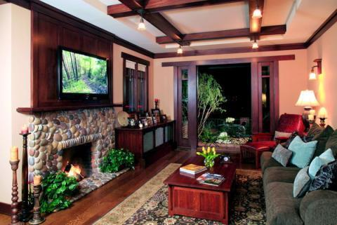 Traditional Family Room with river rock fire place surround
