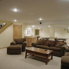 Traditional Basement with light wood stained millwork