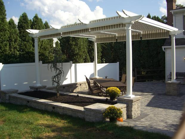 Traditional Gazebo With Outdoor Dining Table And Chairs