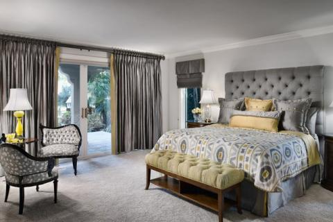 Transitional Bedroom with ceiling to floor drapes