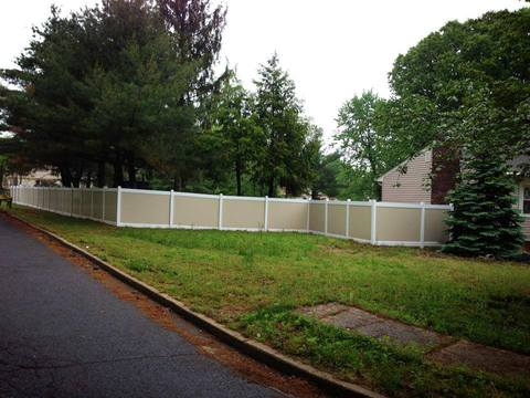 Modern Landscape with tan and white fence