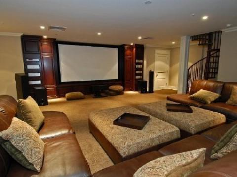 Contemporary Home Theater with fabric and leather upholstery