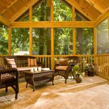 Traditional Sunroom with brown wicker furniture