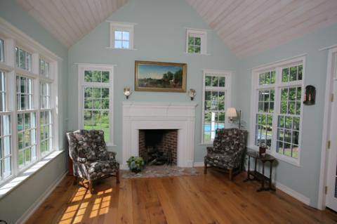 Cape Cod Sunroom with white wood fire place mantel