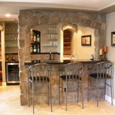 Traditional Basement with built in wine glass rack