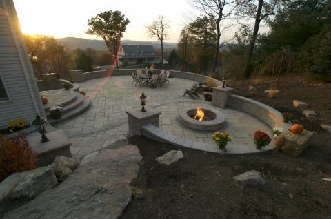 Contemporary Patio with wide round stone steps